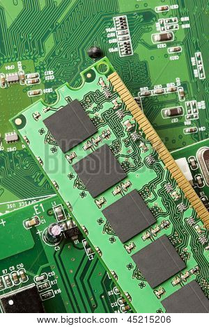 Green Electrical Circuit Board With Microchips And Transistors