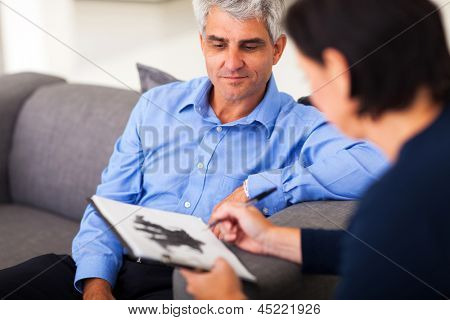depressed middle aged man in session with therapist