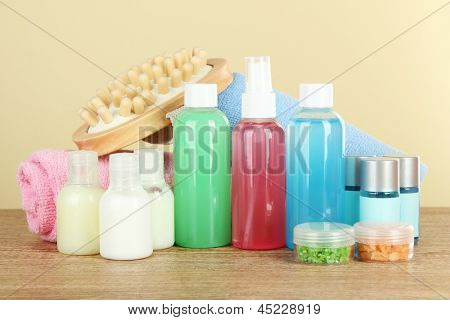 Hotel amenities kit on table on beige background