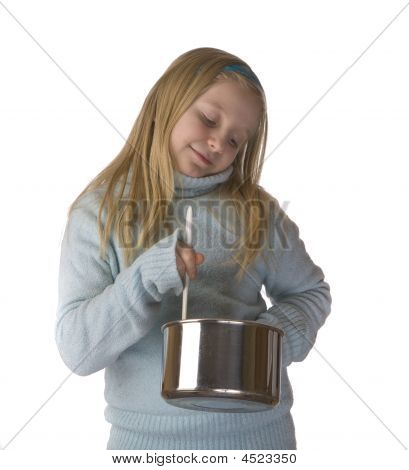 Girl Stirring And Cooking