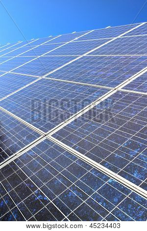 Diagonal solar panel with blue sky in the background