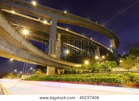 crossing highway overhead at night