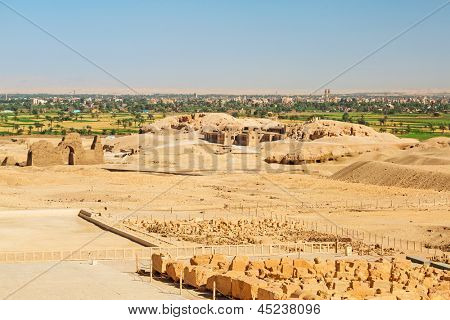 Desert at the Temple of Queen Hatshepsut with archaeologist house in Egypt