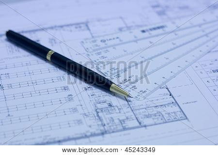 Pen, Scale Ruler And Blueprint