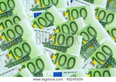 many einhhundert euro banknotes lie side by side. photo icon for wealth and investment