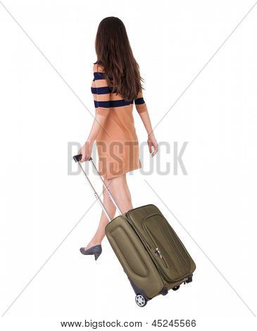 back view walking woman with green suitcase. beautiful brunette girl in motion.  backside view person. Rear view people collection. Isolated over white background. girl on the heels of suitcase rolls