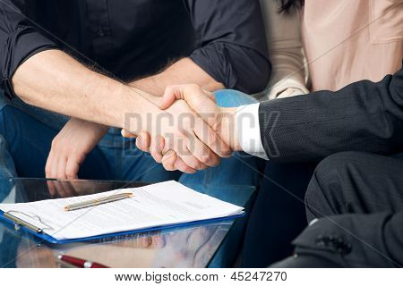 handshake of business peoples