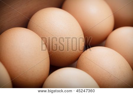 Closeup Eggs In Wood Tray