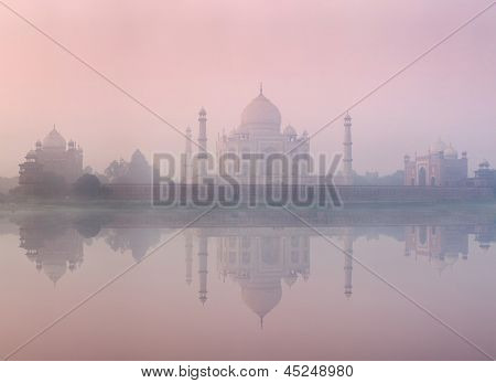 Taj Mahal on sunrise sunset reflection in Yamuna river panorama in fog, Indian Symbol - India travel background. Agra, Uttar Pradesh, India
