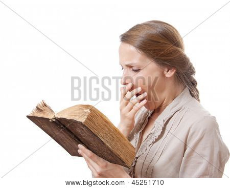 yawning girl reading a boring book, isolated on white