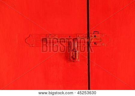 Red Door With Bolt