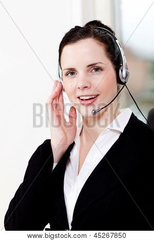 Smiling Young Female Callcenter Agent With Headset