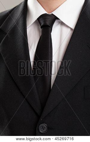 Businessman's torso in suit over grey background
