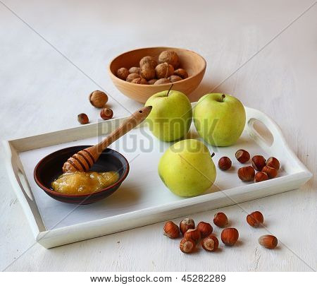Apples, Honey And Nuts On A White Tray