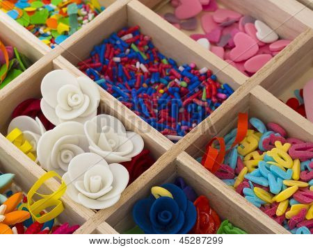 sweet decoration for cakes in the box, colorful background