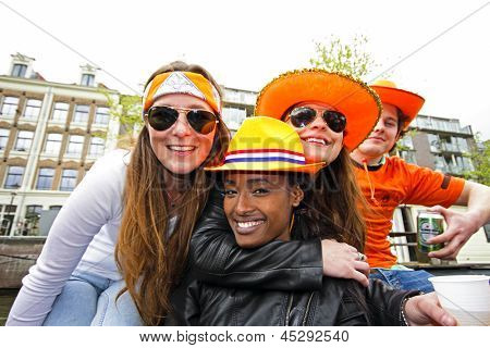 AMSTERDAM, NETHERLANDS - APRIL 30: People in orange celebrating in Amsterdam during the coronation of the new king Willem Alexander from the Netherlands on 30 april 2013