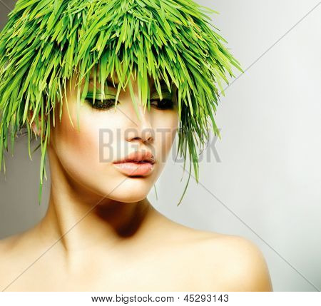 Beauty Spring or Woman with Fresh Green Grass Hair. Summer Nature Girl portrait. Fashion Model