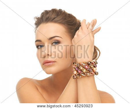 beautiful woman wearing hand jewelry with beads