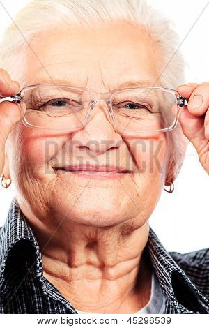 Happy senior woman smiling at the camera. Isolated over white.