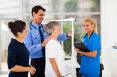 stock photo of measuring height  - general practitioner measuring senior patient - JPG