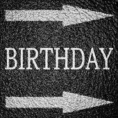 image of b-double  - birthday written on an asphalt background texture - JPG