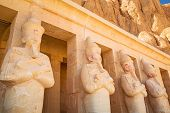 picture of mortuary  - Statues of Queen Hatshepsut in the temple near the Valley of the Kings in Egypt - JPG