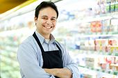 Storekeeper smiling in his grocery store