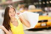 stock photo of cabs  - Happy shopper woman holding shopping bags - JPG