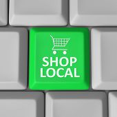 stock photo of local shop  - A green computer key with the words Shop Local and a shopping cart to encourage you to support your community by spending money in your home town - JPG