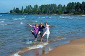picture of three sisters  - Three sisters revisit their childhood and kick and splash in the waters of Lake Superior in Upper Peninsula Michigan - JPG