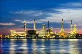 stock photo of refinery  - Petroleum oil refinery factory over sunrise in Bangkok Thailand - JPG