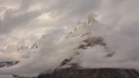 stock photo of skardu  - Trango Towers Hidden in the Clouds Karakorum Mountains Pakistan - JPG