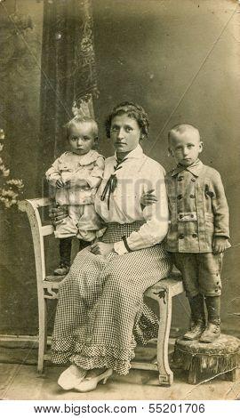 POLAND, CIRCA 1910, vintage photo of mother with son and daughter, Poland, circa 1910