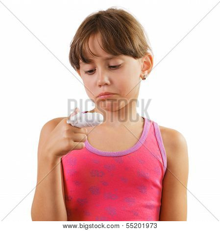 Little Girl With A Bandaged Finger
