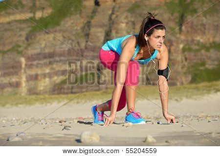 Runner With Earphones Ready For Sprint
