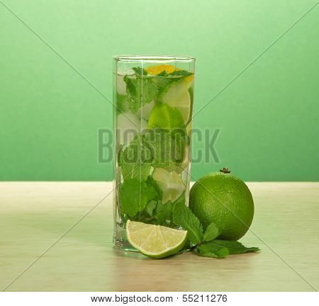 Glass of a mojito, spearmint leaf and juicy lime