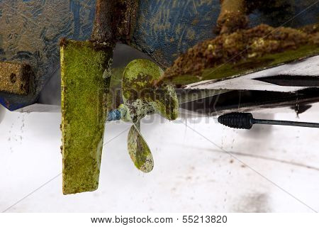 Boat stern hull and propeller pressure water cleaning on beached ship