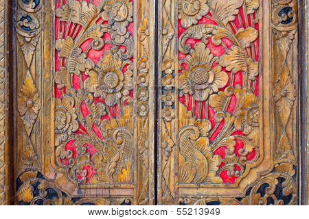 Indian inspired carved colorful golden red wooden door