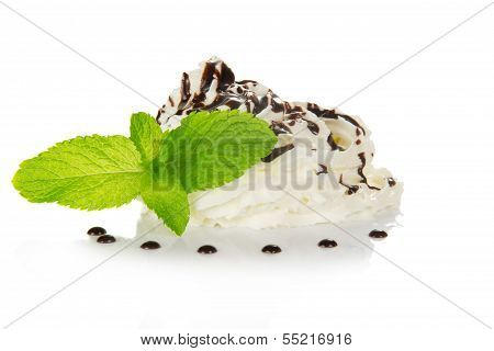Whipped cream is decorated by spearmint and chocolate
