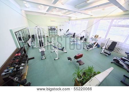 Top view on spacious empty gym with special equipment for physical training