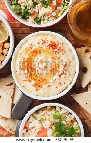 Hummus, chickpea dip with olive oil and ground chili