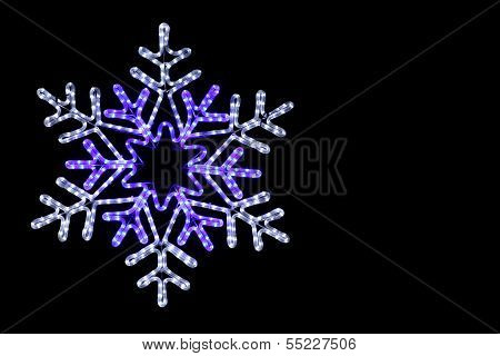 Rope coloured snowflake on a black background