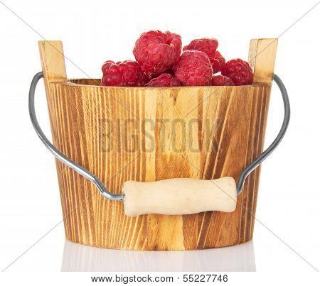 Fresh raspberries in a wooden bucket