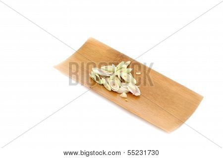 Fresh Lemon Grass And Slice It In Black Dish On White Background.
