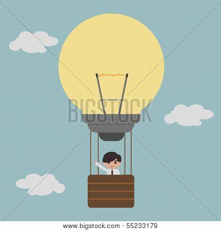 businessman on lightbulb balloon idea