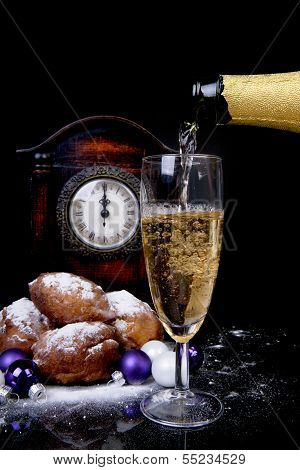 Dutch Donut Also Known As Oliebollen, Traditional New Year's Eve Food, Clock On Midnight And Champag