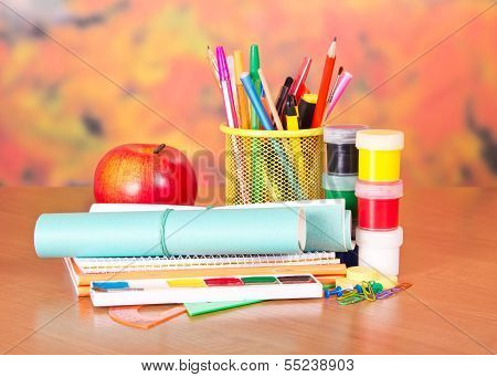 Writing materials, paints and apple