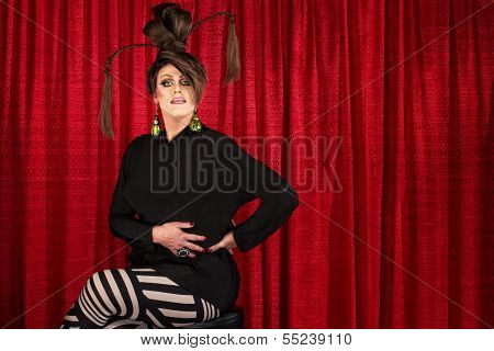 Serious Seated Man In Drag