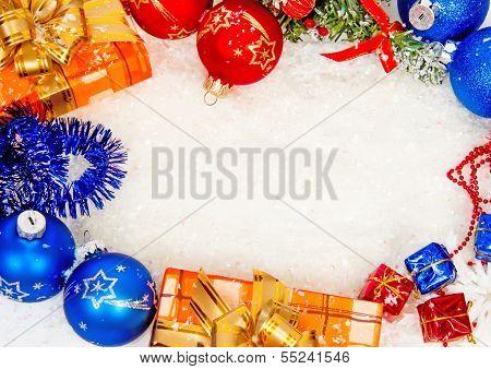 Colorful christmas frame on snow