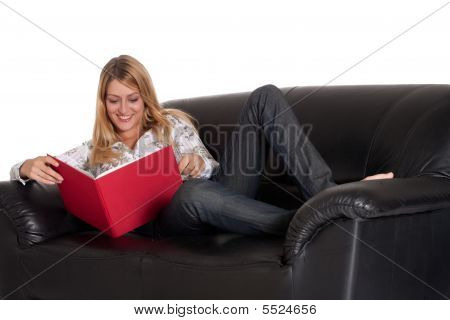 Beautiful Blond Girl Is Reading Her Book